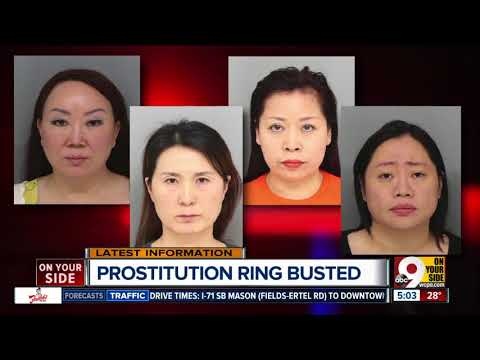 Four charged with prostitution in massage parlor raid