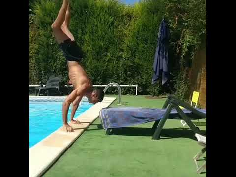 Guy Tries To Lie On Pool Chair After Doing Handstand Out Of Water - 989473