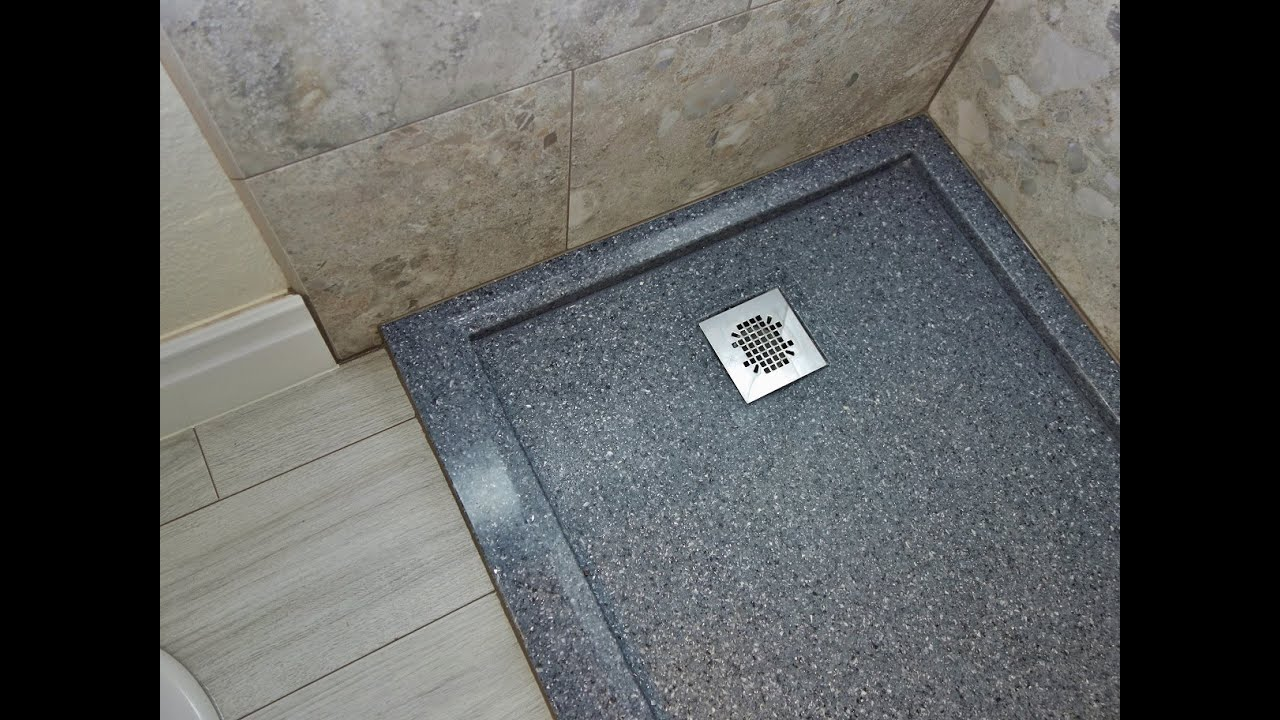 has center is on floor rock shower install how outline to an broken tile the river of floors