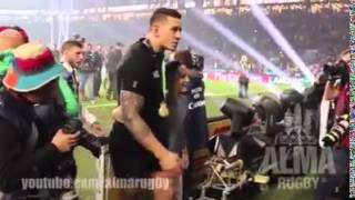 Kid rushes field. Tackled by security guard. Sonny Bill Williams gives him his Rugby World Cup medal