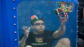 World Record! 8 Rubik's Cubes Solved Underwater thumbnail