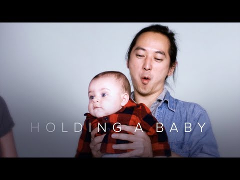 Holding a Baby for the First Time in Slow Motion   First Takes   Cut
