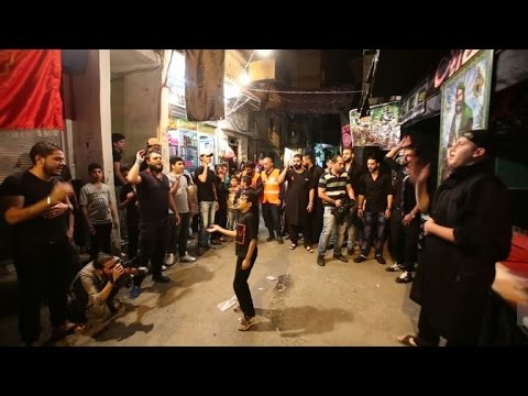 Shiite Muslims attend Ashura prayers in Damascus