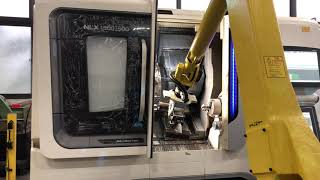 DMG MORI NLX1500 loaded by FANUC Robot with 7th Axis.
