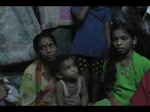 Sitting with a slum family, Mumbai