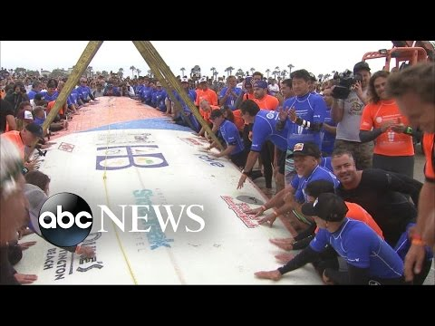 World Record Attempt for Most People Surfing On a Single Board