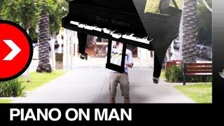 Piano hits man on street