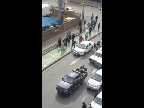 Uber vs local taxi drivers attack uber in hillbrow johannesburg