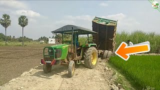 John Deere tractor stuck in soil road with Tractor Trailer   Come To Village