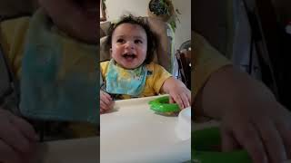 Baby laughing hysterically at spitting sound
