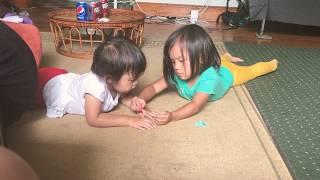 Chloe putting nail polish on Luna