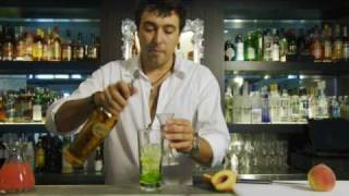 "How To Make A Rum Based Cocktail With Midori Liqueur. ""peach Fizz """