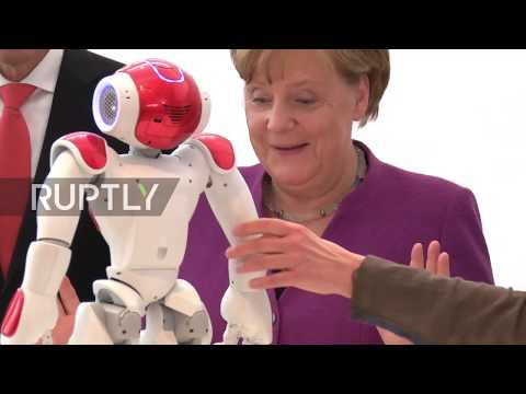 Germany: Merkel gets pally with robot at the Chancellery