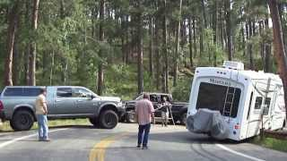 "Old man drives his trailer into a narrow winding ""small cars only"" road and gets stuck"