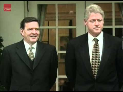 Clinton and Gerhard Schroeder speaking about military strikes in Kosovo