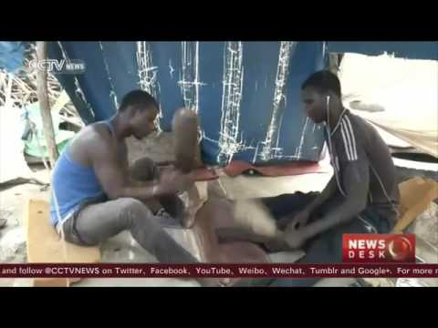 24458 Mittelstand fashion CCTV Dyers from West Africa give clothes new lease of life