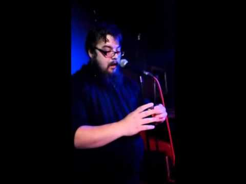 Solving a Rubik's Cube while singing karaoke at the bar