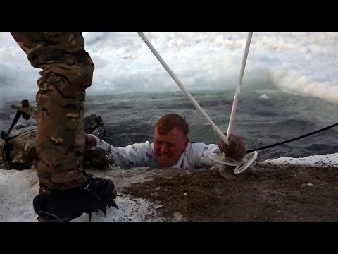 British Royal Marines Commandos train US Marines to survive in freezing water.