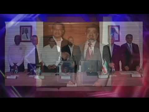GOB Signs Loan Agreement with Kuwait Fund for Arab Economic Development for Caracol Road Project