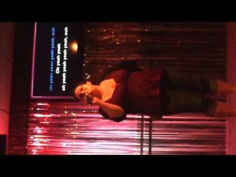 Tranny sings Karaoke