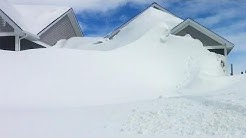Jaw-dropping amounts of snow cover homes in New Brunswick community, see it