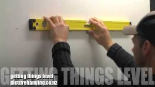 The best way to hang your picture frames straight and in a row