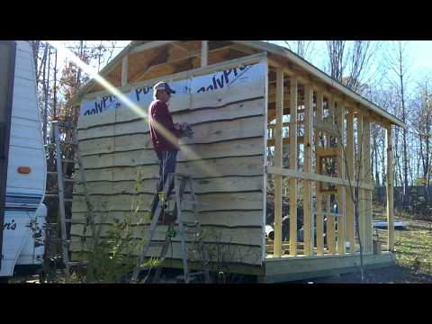Live edge siding on the rustic cabin.