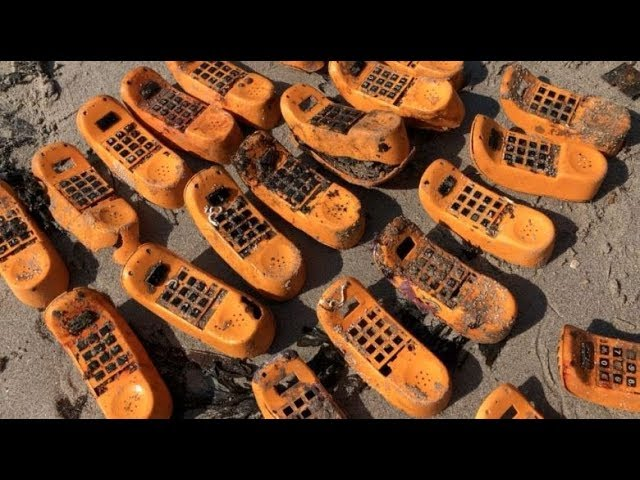 898e9b09d1 Decades-old mystery of Garfield phones washing up on French beaches is  SOLVED