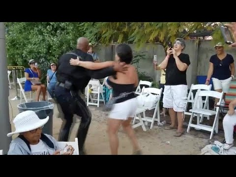 Police officer shows off salsa moves at Cuban-American festival