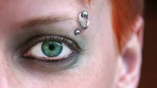 50 of the Most Amazing Eyebrow Piercing Designs