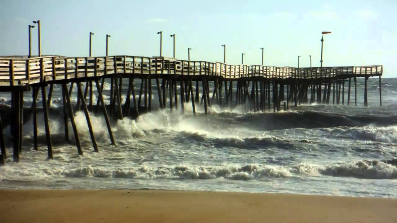 Huge waves crashing on avalon fishing pier in kill devil for Surf city pier fishing report