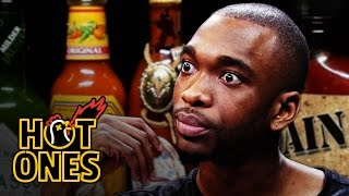 Download Jay Pharoah Has a Staring Contest While Eating Spicy Wings   Hot Ones Mp3 and Videos