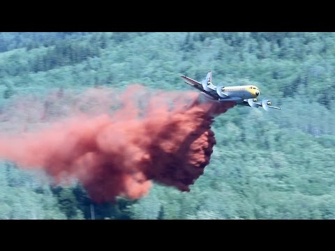 Lockheed Electra L-188 Air Tanker Battles Wildfire In Northern British Columbia - Stock Footage