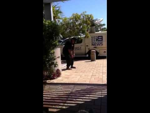 Old guy grooving outside southport court house