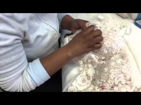 Beading a wedding gown at Elbeth Gillis Bridal