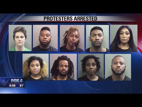 'Dallas 9' arrested after protest outside Cowboys game over Botham Jean Killing