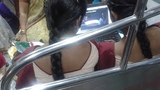 Two School Girls Watching Movie in Train