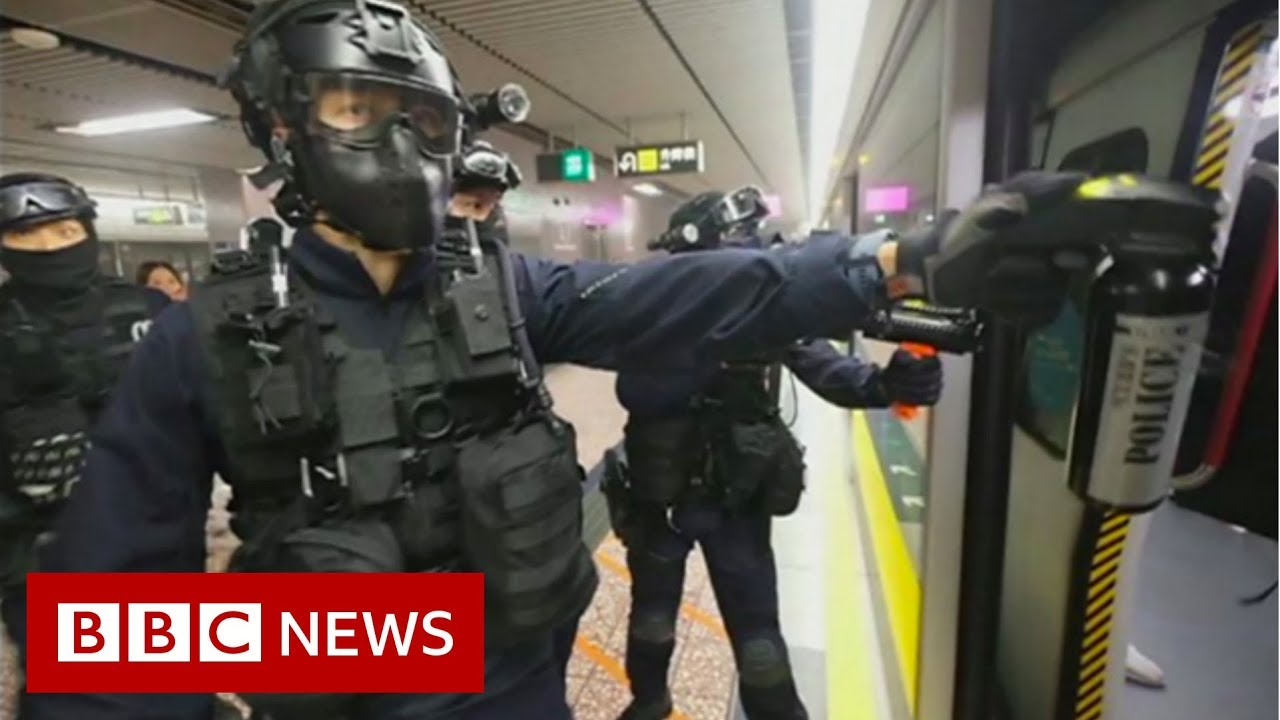 Hong Kong police storm metro system after protests - BBC News