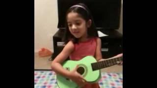 Mina singing Pakistani songs w/ her Guitar