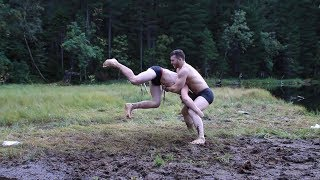 Young Russian muscle brothers wrestling and flexing