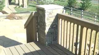 Flagstone Patio And Composite Deck Installed By A Denver Deck And Landscape Contractor
