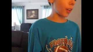 little 9 year old boy singing 2 chain we own it Saturday with lemonhead