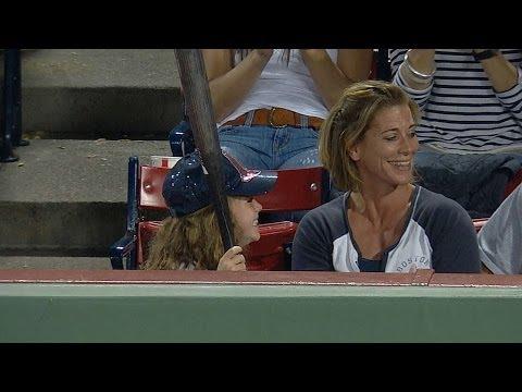 Gomes hands broken bat to a young Sox fan