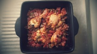 Roast chicken with onion, tomato and capsicum