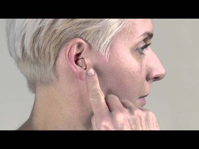 Adjusting the volume on your custom hearing aid