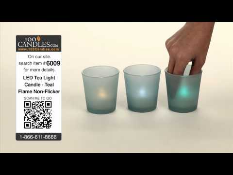 Turquoise Glass Cylinder Candle Holder With A Variety Of Tea Lights