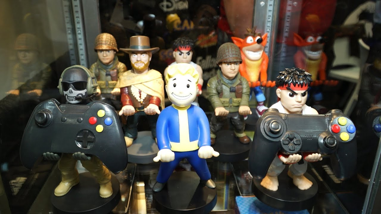 toy fair 2018 cable guys phone and controller holder figures  [ 1280 x 720 Pixel ]