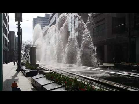 Metro train running through a water feature on Main Street in Downtown Houston.