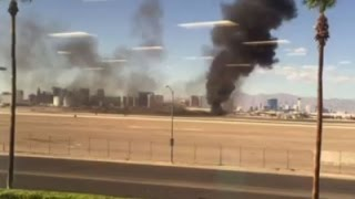 Raw: Plane Burns on Las Vegas Airport Runway