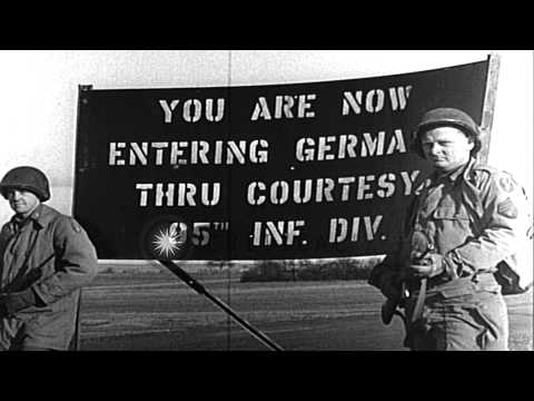 US 95th Infantry Division troops on vehicles entering Saarlautern, Germany, in Wo...HD Stock Footage